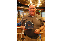 NAD Family Ministries Director Claudio Consuegra passes out ASAM hats.