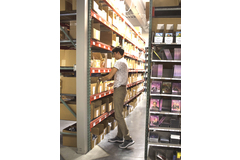 A student worker picks and packs orders at AdventSource in Lincoln, Nebraska